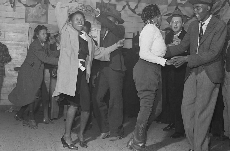 Several people are dancing Jitterbugg in a Black juke joint on Saturday evening outside Clarksdale, Mississippi Delta